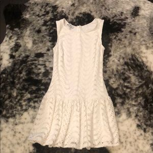 White eyelet Bebe mini dress.